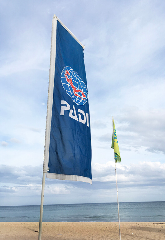 flag of PADI, the world's leading scuba diver training and certification organization