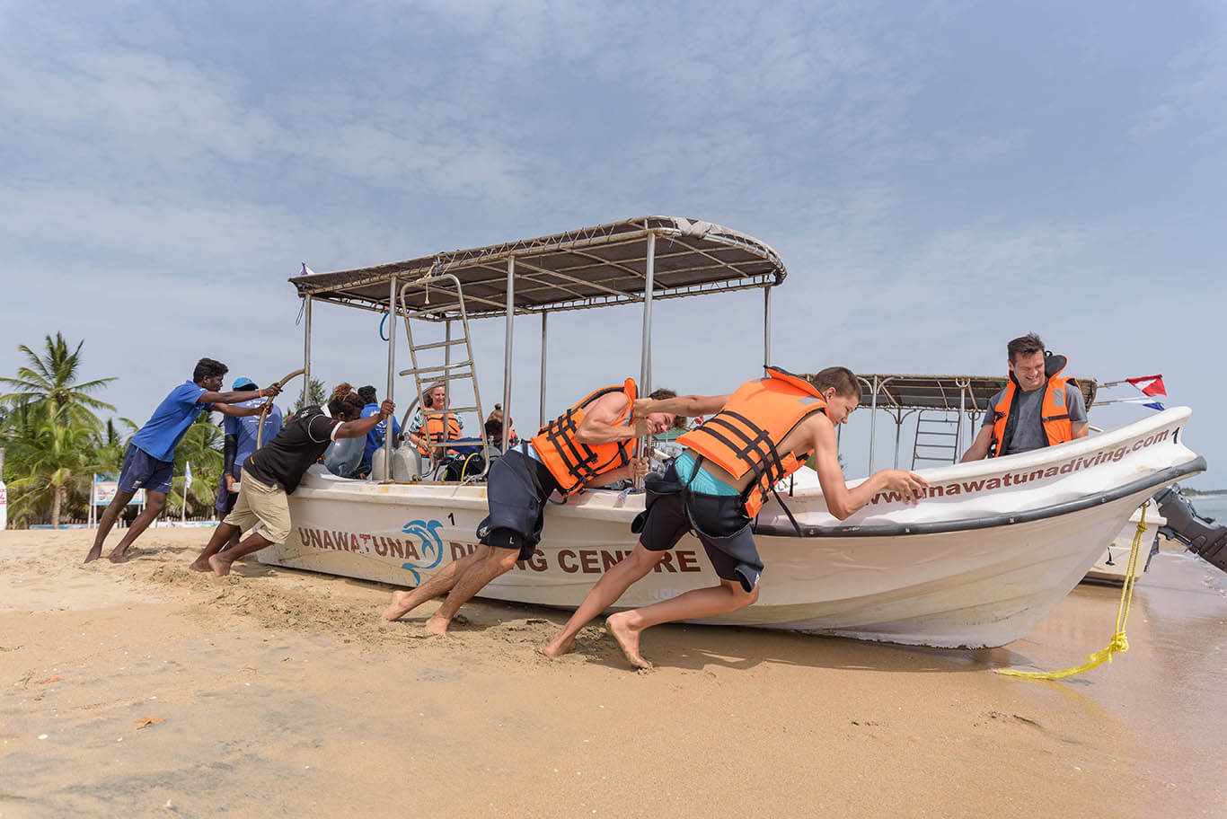 pushing diving boats to the sea in Sri Lanka